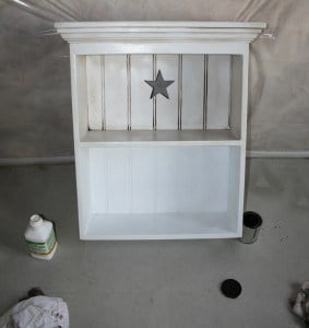 A shelf at the midway point. Top half has been painted and stained, bottom half has not yet.