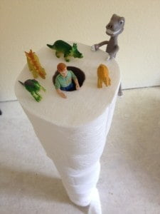 Dinosaurs scaling the famous Leaning Tower of TP