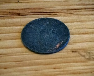The penny (barely recognizable) that launched a thousand profanities.