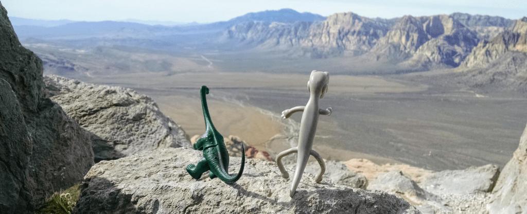 Frugalsaurus and Spendosaurus sharing a quiet moment in the Nevada desert