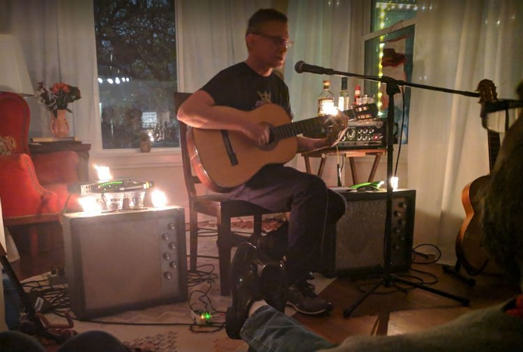 Matt Talbott, lead singer of Hum performs in a living room show.