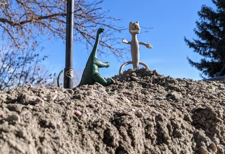 dinosaurs moving rocks